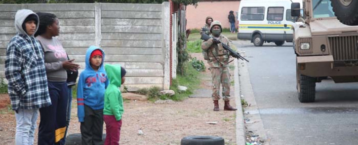 FILE: Children standing on the pavement during SANDF operations in Elsies River. Picture: Bertram Malgas/EWN