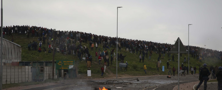 FILE: Police officers engaged in running battles with the protesters as they attempted to disperse the crowd of disgruntled Zwelihle residents on 12 July 2018. Picture: Cindy Archillies/EWN