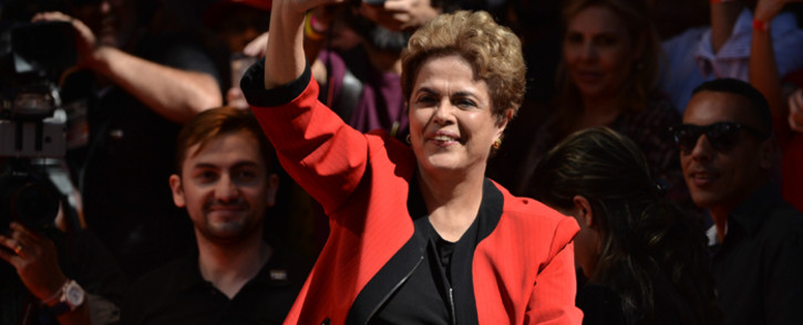 Brazilian President Dilma Rousseff waves at the crowd during a demonstration to mark International Workers' Day, in Sao Paulo, Brazil, on 1 May, 2016. Picture: AFP.
