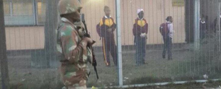 FILE: An SANDF member guard the street next to the school in Manenberg following Operation Fiela in the area on 21 May 2015. Picture: @SAPoliceService/Twitter
