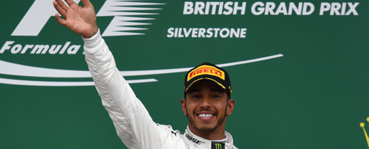 Winner Mercedes' British driver Lewis Hamilton celebrates on the podium after the British Formula One Grand Prix at the Silverstone motor racing circuit in Silverstone, central England on 16 July 2017. Picture: AFP
