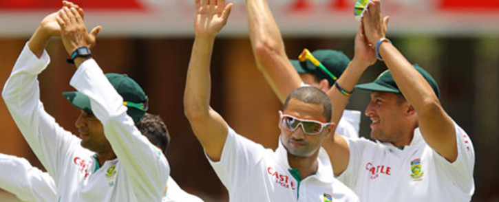 FILE: South African cricket players. AFP PHOTO ANESH DEBIKY
