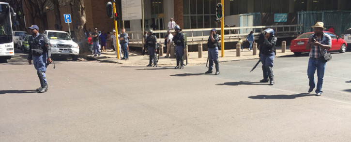 FILE: Police watch as students from the Tshwane University of Technology demonstrate in Pretoria CBD. Picture: Kgothatso Mogale/EWN.