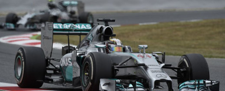 FILE: Mercedes-AMG's British driver Lewis Hamilton and his German team-mate Nico Rosberg in the background. Picture: AFP