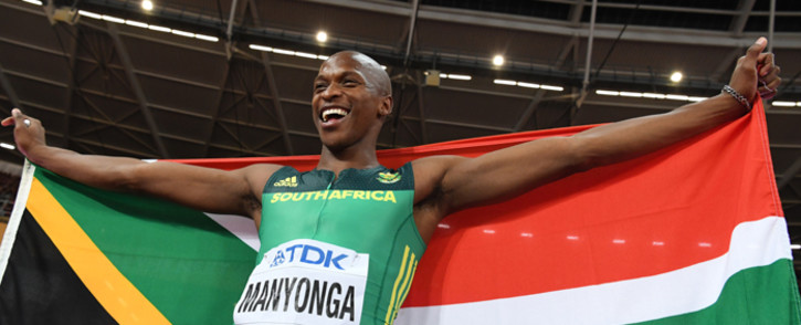 FILE: Gold medallist South Africa's Luvo Manyonga celebrates after the final of the men's long jump athletics event at the 2017 IAAF World Championships at the London Stadium in London on 5 August 2017. Picture: AFP.