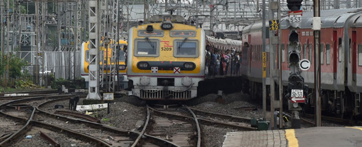 A local passenger train approaches a platform in Mumbai on 5 July 2019. Picture: AFP.