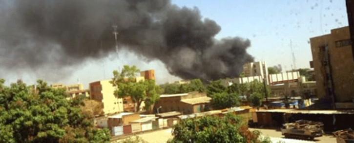 A YouTube screengrab shows black smoke rising from Burkina Faso's military headquarters in Ouagadougou.