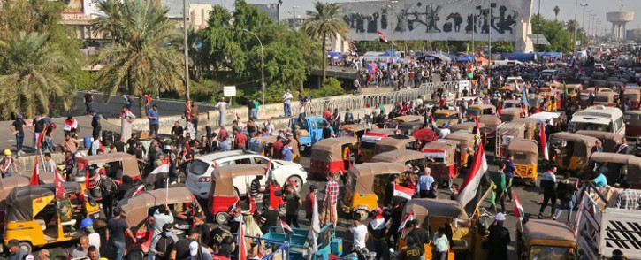 Iraqi protesters gather at Tahrir Square during ongoing anti-government demonstrations in the capital Baghdad on 1 November 2019. Picture: AFP