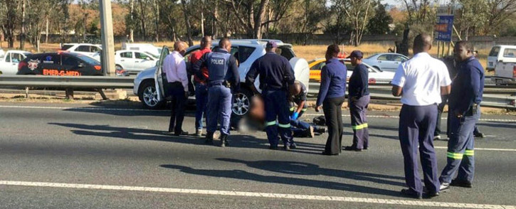 Police and paramedics at the scene of a police shoot out on the N1 on 18 August 2016. Picture: Twitter: @EMER_G_MED