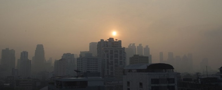A layer of smog blankets the Thai capital Bangkok on 14 January 2019. Thai authorities are set to deploy rain-making planes to combat the pall of pollution that has shrouding the capital in recent weeks.  Picture: AFP