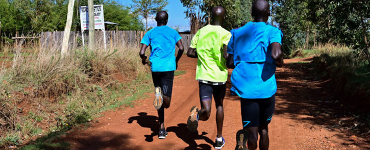 FILE: Marathon runners carry out a 'speed-work' along the back roads Iten, known colloquially as the 'world's running capital', legendary for producing some of Kenya's most elite athletes and a training ground for other international top distance runners on 9 May 2019. Picture: AFP