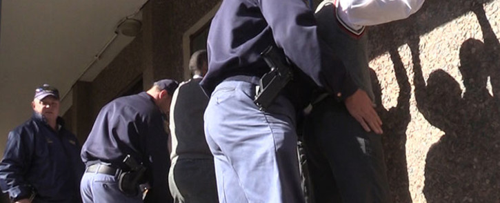 Police search pupils at Westbury Secondary High School in Johannesburg on 5 September, 2014. Picture: Vumani Mkhize/EWN.
