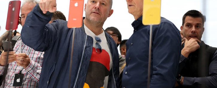 Apple chief design officer Jony Ive (L) and Apple CEO Tim Cook inspect the new iPhone XR during an Apple special event at the Steve Jobs Theatre on 12 September, 2018 in Cupertino, California. Picture: AFP