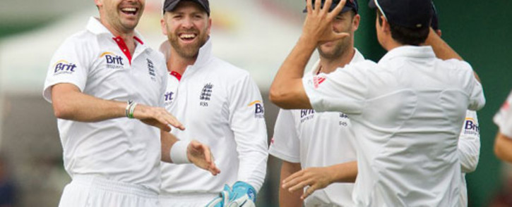 England's James Anderson (L) celebrates with team mates captain Alastair Cook (R) Nick Compton and keeper Matt Prior. Picture: AFP
