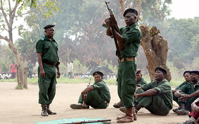 FILE: A file picture taken in Gorongosa's mountains shows fighters of former Mozambican rebel movement Renamo receive military training. Jinty Jackson/AFP