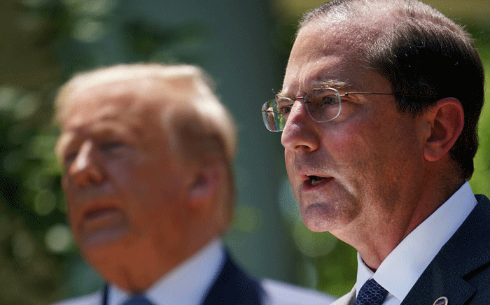 In this file photo taken on 15 May 2020 shows US Secretary of Health and Human Services Alex Azar (R) speaking in the Rose Garden of the White House in Washington, DC as US President Donald Trump (L) looks on. Picture: AFP