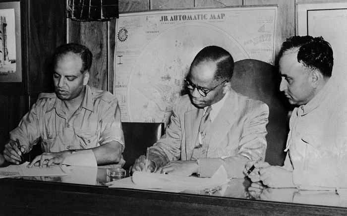 FILE: From L to R : Doctors GM Naicker, known as Monty Naicker, President of the Natal Indian Congress, Alfred Bitini Xuma, President of the ANC and Yusuf Mohamed Dadoo, President of the Transvaal Indian Congress sign, 9 March 1947, the historic pact of cooperation between the ANC and the Indian Congresses, consolidating the spirit of fraternity and solidarity between the African and Indian communities in South Africa. Picture: AFP