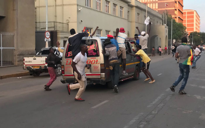 Zimbabweans in the streets of Harare celebrate Mugabe's resignation as president of the troubled country. Picture: EWN