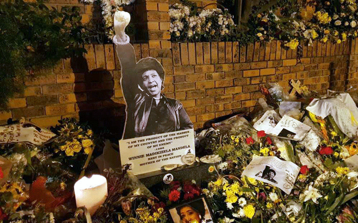 Flowers were placed outside Winnie Madikizela-Mandela's home in Soweto, on 14 April 2018, ahead of official funeral proceedings. Picture:  Louise McAuliffe/EWN.