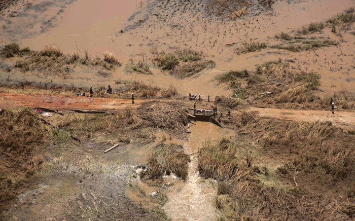 People in a flooded area just outside Beira after Cyclone Idai hit Mozambique and other southern African countries. Picture: Christa Eybers/EWN.