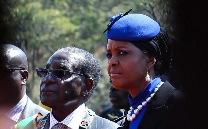 Zimbabwe's President Robert Mugabe and his wife Grace stand by the monument of the Unknown Soldier during Heroes Day commemorations in Harare on 10 August 2015. Picture: AFP