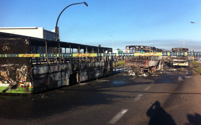 The remains of Golden Arrow buses at the Nyanga bus terminus which were burnt on 1 September, 2014 during protests. Picture: Carmel Loggenberg/EWN.