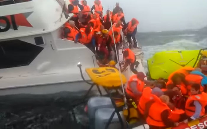 FILE: Screengrab of crew members and passengers rescued from a sinking Robin Island ferry, two passengers were treated at a local hospital.