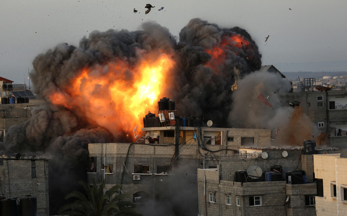 A ball of fire erupts from a building in Gaza City's Rimal residential district on 16 May 2021, during massive Israeli bombardment on the Hamas-controlled enclave. Picture: Bashar TALEB/AFP