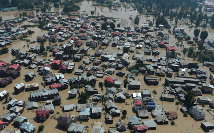 Kashmiri houses submerged by floodwaters are seen from an Indian Air Force helicopter during rescue and relief operations in Srinagar on 10 September, 2014. Picture: AFP.