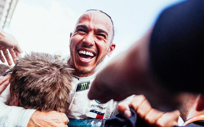 Mercedes' Lewis Hamilton celebrates with his team after beating Valtteri Bottas in the Spanish Grand Prix. Picture: @MercedesAMGF1/Facebook.com.
