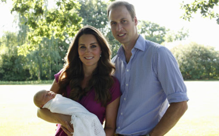 FILE: Prince William, his wife Catherine and their son Prince George, at the Middleton family home in Bucklebury, Berkshire, in early August, 2013. Picture: AFP.
