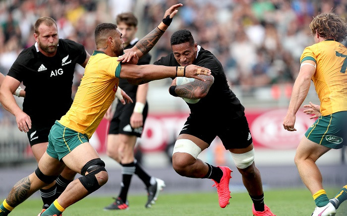 Australia's Lukhan Salakaia-Loto (L) tackles New Zealand's Shannon Frizell (C) during the second Bledisloe Cup rugby union match between New Zealand and Australia in Auckland on October 18, 2020. Picture: AFP