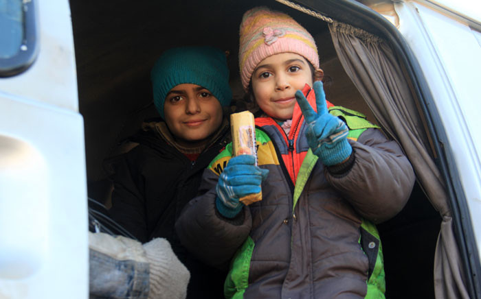 FILE: Syrian children, who were evacuated from the last rebel-held pockets of Syria's northen city of Aleppo, flash the sign of victory upon their arrival on 19 December 2016. Picture: AFP.