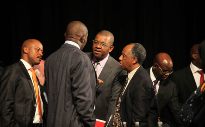 Dali Mpofu and Dumisa Ntsebeza chat during the Marikana Commission of Inquiry on 3 Oct 2012. Picture: Taurai Maduna/EWN.