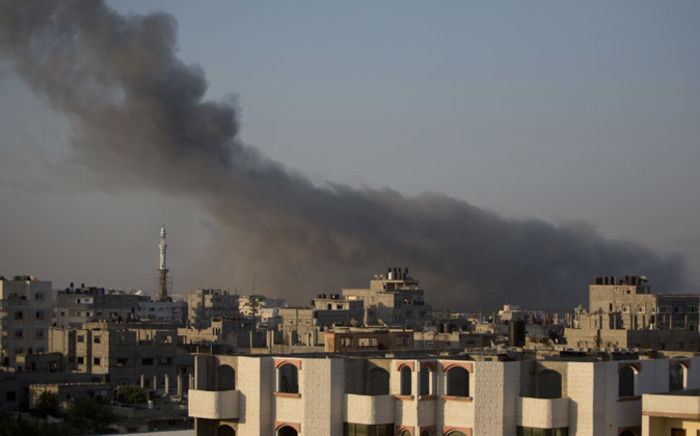 Smoke billows from buildings following an Israeli air strike in Gaza City early on 10 July, 2014. The Israeli air force overnight hit more than 300 Hamas targets in the Gaza Strip in response to rocket fire from the besieged Palestinian territory, an army spokesman said. Picture: AFP.
