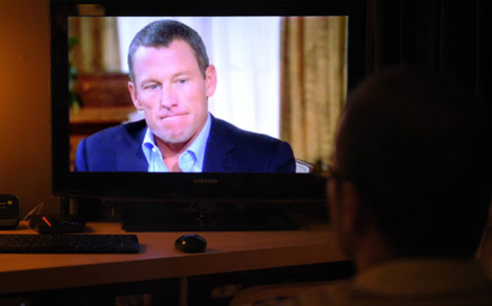 "A photo illustration shows a man watching a TV showing disgraced cycling star Lance Armstrong being interviewed by Oprah Winfrey on January 17, 2013 in Kensington, Maryland. Armstrong said in the interview that he was ""sorry"" for taking performance-enhancing drugs during his career and that it was a mistake."