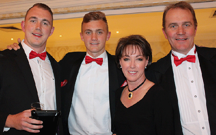 Nikki Bush pictured with her husband Simon, and their sons Ryan and Matthew. Picture: Supplied.