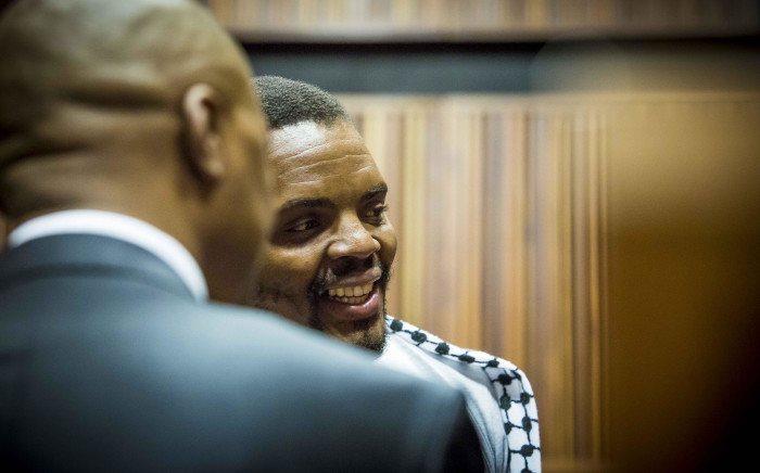 FILE: Mcebo Dlamini talks to his legal representatives before proceedings at his bail appeal began at the Palm Ridge magistrates court in Thokoza. Picture: Thomas Holder/EWN.
