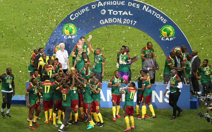 FILE: Cameroon's players celebrate with the trophy at the end of the 2017 Africa Cup of Nations final football match between Egypt and Cameroon at the Stade de l'Amitie Sino-Gabonaise in Libreville on 5 February 2017. Picture: AFP.