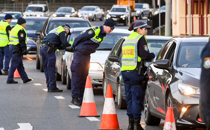 Police in the southern New South Wales (NSW) border city of Albury check cars crossing the state border from Victoria on 8 July 2020 after authorities closed the border due to an outbreak of COVID-19 coronavirus in Victoria. Picture: AFP