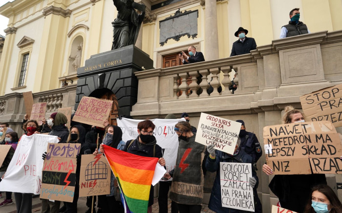People protests in front of church against church support for tightening Poland's already restrictive abortion law in Warsaw on October 25, 2020. Pic: AFP
