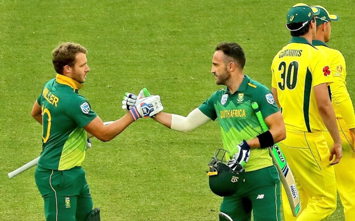 FILE: David Miller and Faf du Plessis shake hands during their match against Australia. Picture: @OfficialCSA/Twitter.