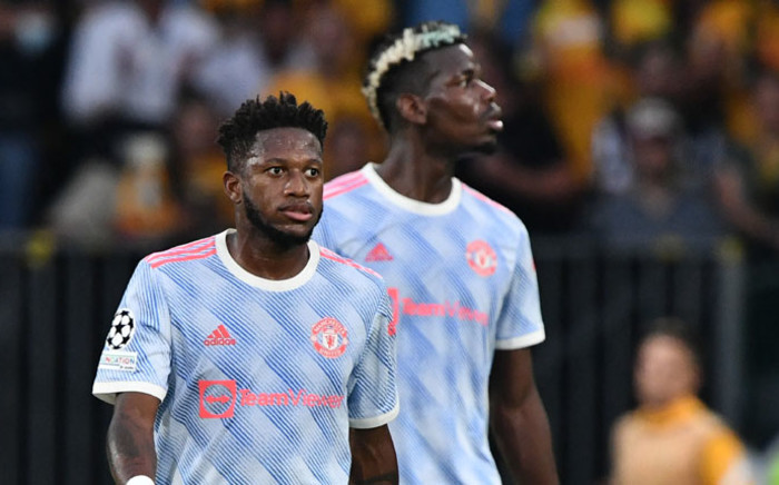 Manchester United midfielder Fred (L) and teammate Paul Pogba are seen during the UEFA Champions League Group F football match between Young Boys and Manchester United at Wankdorf stadium in Bern, on 14 September 2021. Picture: Fabrice Coffrini/AFP
