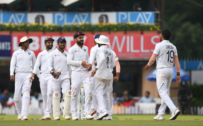 India's cricket team captain Virat Kohli (C) celebrates with India's Umesh Yadav (R) and teammates after the dismissal of South Africa's George Linde during the third day of the third and final Test match between India and South Africa at the Jharkhand State Cricket Association (JSCA) stadium in Ranchi on 21 October 2019. Picture: AFP