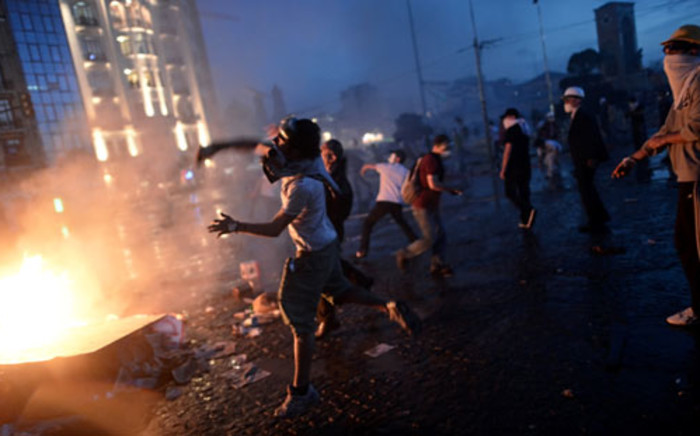 """Protesters in Turkey clash with riot police in Taksim Square, Istanbul. Picture: AFP"""""""