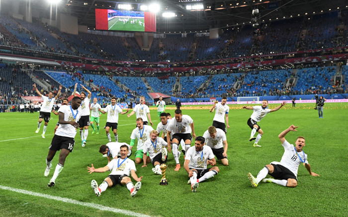 Germany's players run towards the trophy after winning the 2017 Confederations Cup final football match between Chile and Germany at the Saint Petersburg Stadium in Saint Petersburg on 2 July, 2017. Picture: AFP.