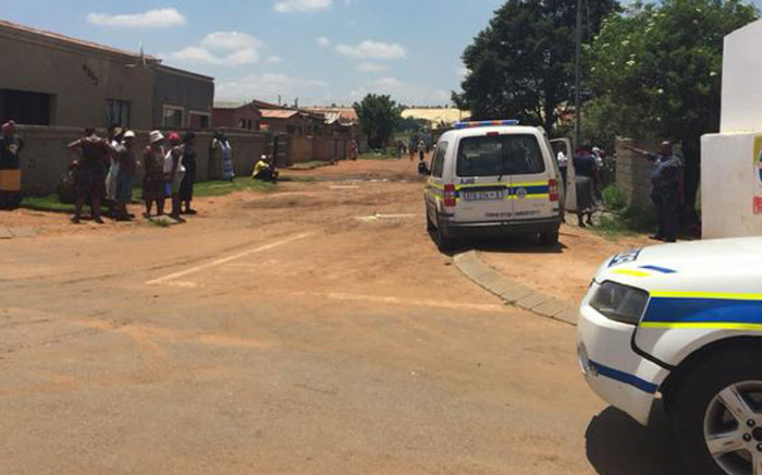 Police are stationed at most foreign-owned shops after many business owners left saying they fear for their lives. Picture: Thando Kubheka/EWN.