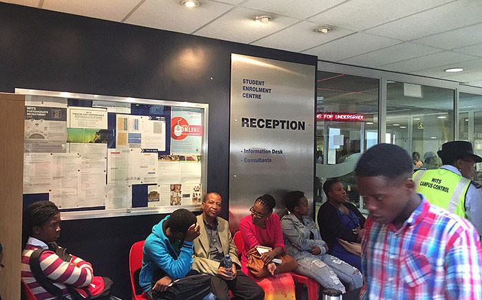 Wits Fees Must Fall members protested on 11 January 2016 as first years queued around them for registration. Picture: EWN/Govan Whittles.