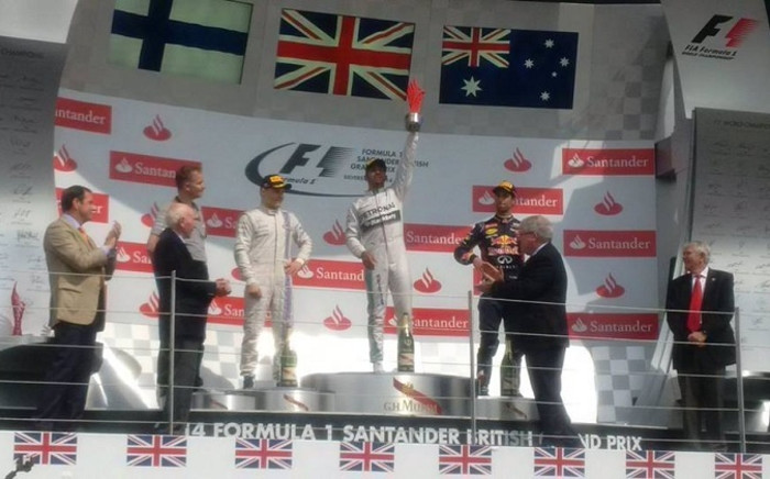 Lewis Hamilton hoists his British Grand Prix trophy in the air after winning at Silverstone. Picture: Official Mercedes AMG F1 Facebook page