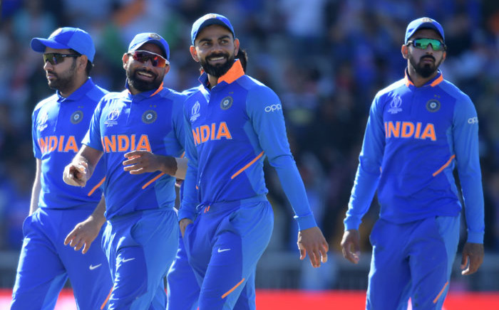 India's captain Virat Kohli (C) and teammates at end of play during the 2019 Cricket World Cup group stage match between West Indies and India at Old Trafford in Manchester, northwest England, on 27 June 2019. India beat West Indies by 125 runs. Picture: AFP